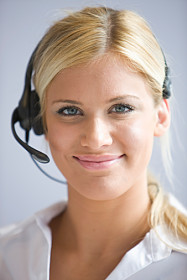 Portrait of Business woman wearing telephone heads